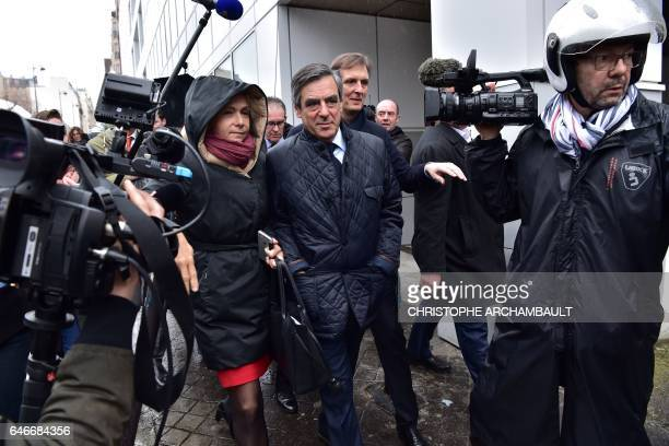 French presidential election candidate for the right-wing Les Republicains party Francois Fillon , flanked by Fillon's campaign spokesperson Jerome...
