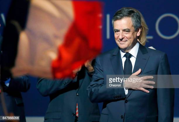 French presidential election candidate for the rightwing 'Les Republicains' party Francois Fillon acknowledges the public after a campaign rally to...