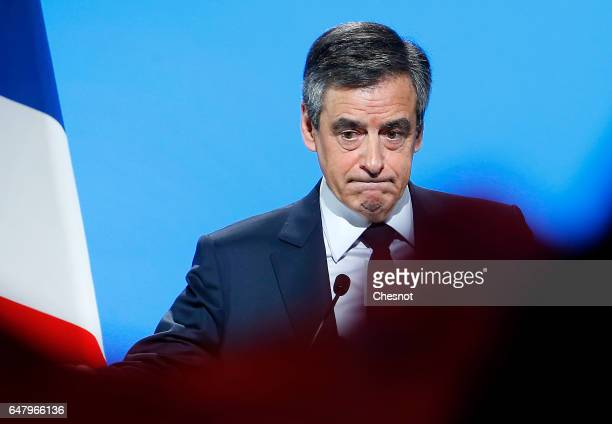 French presidential election candidate for the rightwing Les Republicains party Francois Fillon acknowledges the public after a campaign rally to...