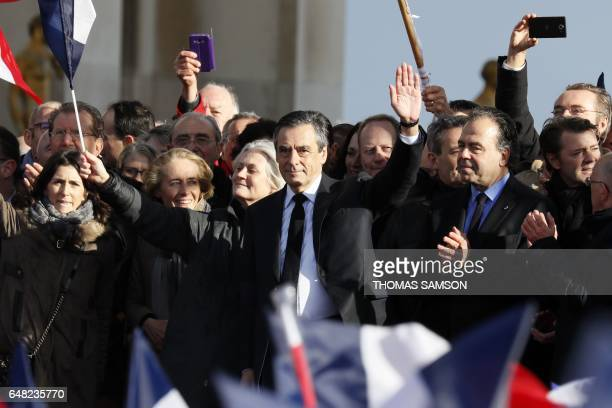 French presidential election candidate for the rightwing Les Republicains party Francois Fillon flanked by his wife Penelope Fillon his daughter...