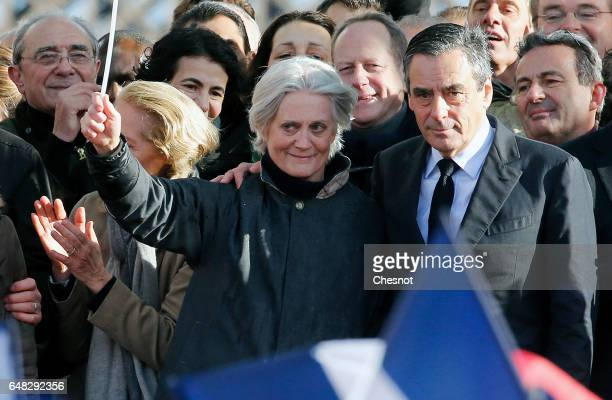 French presidential election candidate for the rightwing Les Republicains party Francois Fillon flanked by his wife Penelope Fillon acknowledges the...