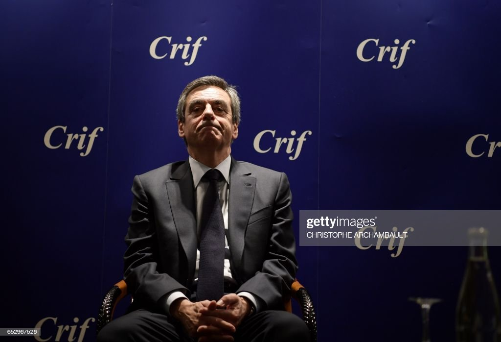TOPSHOT - French presidential election candidate for the right-wing Les Republicains (LR) party Francois Fillon looks on as he sits during a conference at the Jewish Institutions Representative Council (Conseil Representatif des Institutions juives de France - CRIF) on March 13, 2017 in Paris. / AFP PHOTO / Christophe ARCHAMBAULT