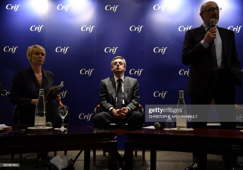 French presidential election candidate for the right-wing Les Republicains (LR) party Francois Fillon (C) sits during a conference at the Jewish Institutions Representative Council (Conseil Represe...