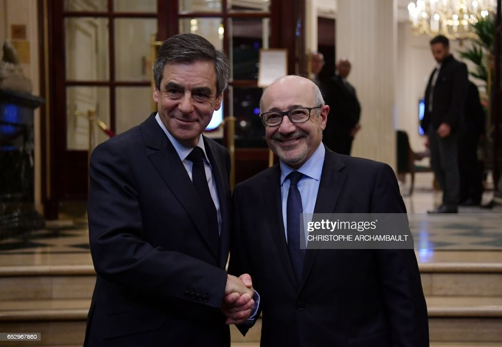 French presidential election candidate for the right-wing Les Republicains (LR) party Francois Fillon (L) shakes hands with Francis Kalifat president of the Jewish Institutions Representative Council (Conseil Representatif des Institutions juives de France - CRIF) before a conference on March 13, 2017 in Paris. / AFP PHOTO / Christophe ARCHAMBAULT