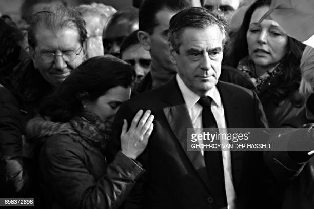 French presidential election candidate for the rightwing Les Republicains party Francois Fillon stands on stage next to his daughter Marie Fillon...