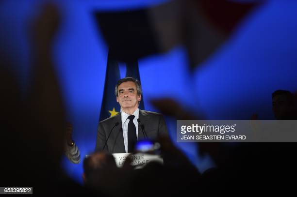 TOPSHOT French presidential election candidate for the rightwing Les Republicains party Francois Fillon delivers a speech during a campaign meeting...