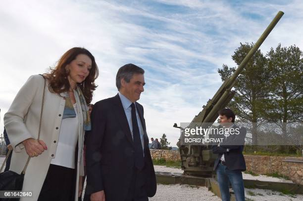 French presidential election candidate for the rightwing Les Republicains party Francois Fillon and French MP Valerie Boyer speak to one another...