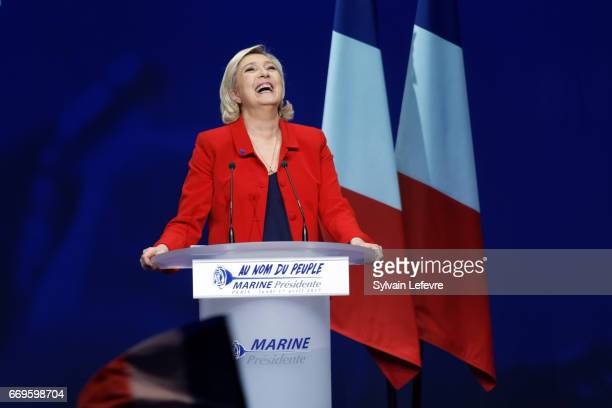 French presidential farright candidate Marine Le Pen gestures as she delivers a speech during a campaign rally at Zenith on April 17 2017 in Paris...