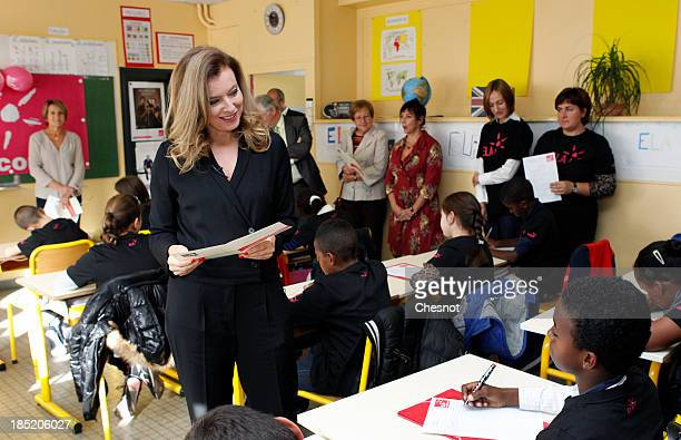 French President's companion Valerie Trierweiler meets pupils during a visit in a classroom to support the ELA at the Paul Valery school on October...