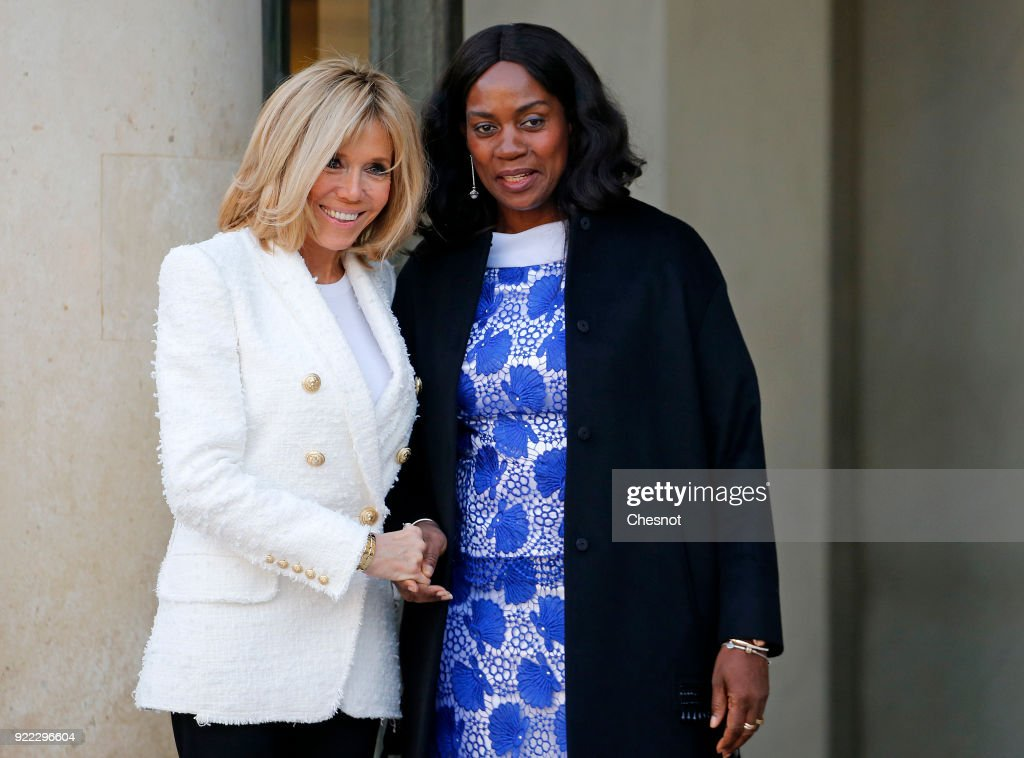 French President's wife Brigitte Macron accompanies Liberia President's wife Clar Weah after their lunch with French President Emmanuel Macron and Liberian President George Weah at the Elysee Palace on 21 February, 2018 in Paris, France. Weah is a former international soccer player and was elected President of the Republic of Liberia on January 22, 2018, he is currently on an official visit to France.
