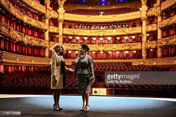 TOPSHOT French president's wife Brigitte Macron and Chinese president's wife Peng Liyuan visit the Palais Garnier opera house in Paris on March 25 as...