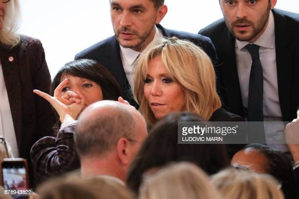 French President's wife Brigitte Macron and French humorist and patron of the association 'Women Safe' Florence Foresti talk within a president's...