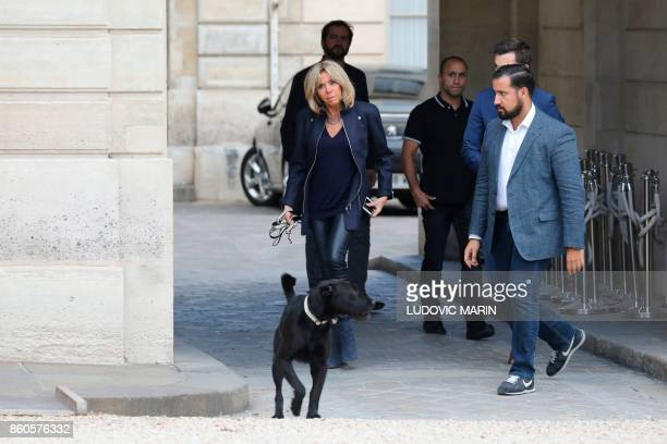 French President's wife Brigitte Macron arrives with the president's dog Nemo as Elysee senior security officer Alexandre Benalla looks on at the...