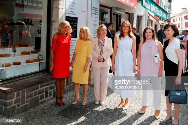 French President's wife Brigitte Macron European Council President's wife Malgorzata Tusk Chile's First Lady Cecilia Morel US First Lady Melania...