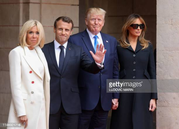 French President's wife Brigitte Macron French President Emmanuel Macron US President Donald Trump and US First Lady Melania Trump pose prior to...