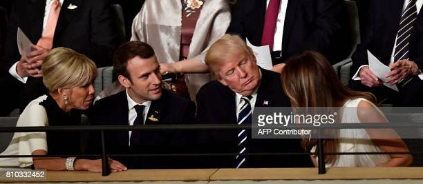 French President's wife Brigitte Macron French President Emmanuel Macron US President Donald Trump and US First Lady Melania Trump chat prior to a...