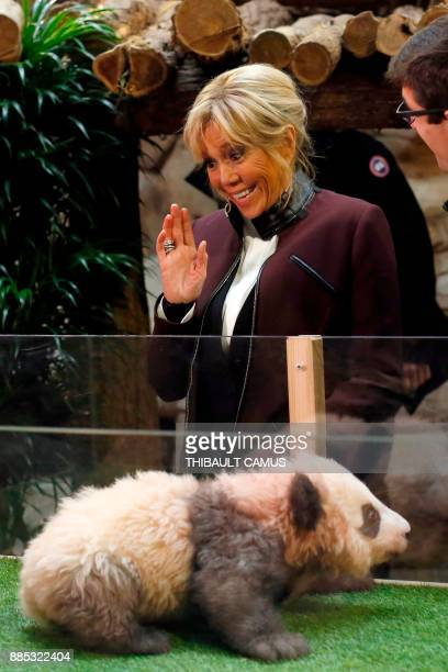 French president's wife Brigitte Macron gestures as she attends a naming ceremony for male panda cub Yuan Meng which was born at the Beauval zoo on...