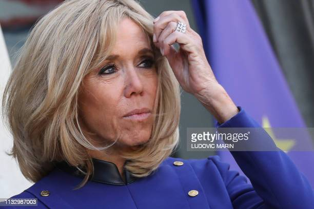 TOPSHOT French president's wife Brigitte Macron looks on after accompanying back the Chinese president and his wife following a meeting at the Elysee...