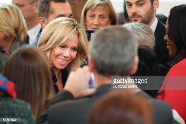 French President's wife Brigitte Macron meets with guests following the president's speech on the International Day for the Elimination of Violence...