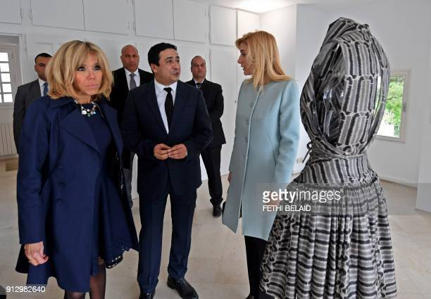 French President's wife Brigitte Macron poses for a picture with the wife of Tunisia's prime minister Hela Chahed during their visit to the home of...