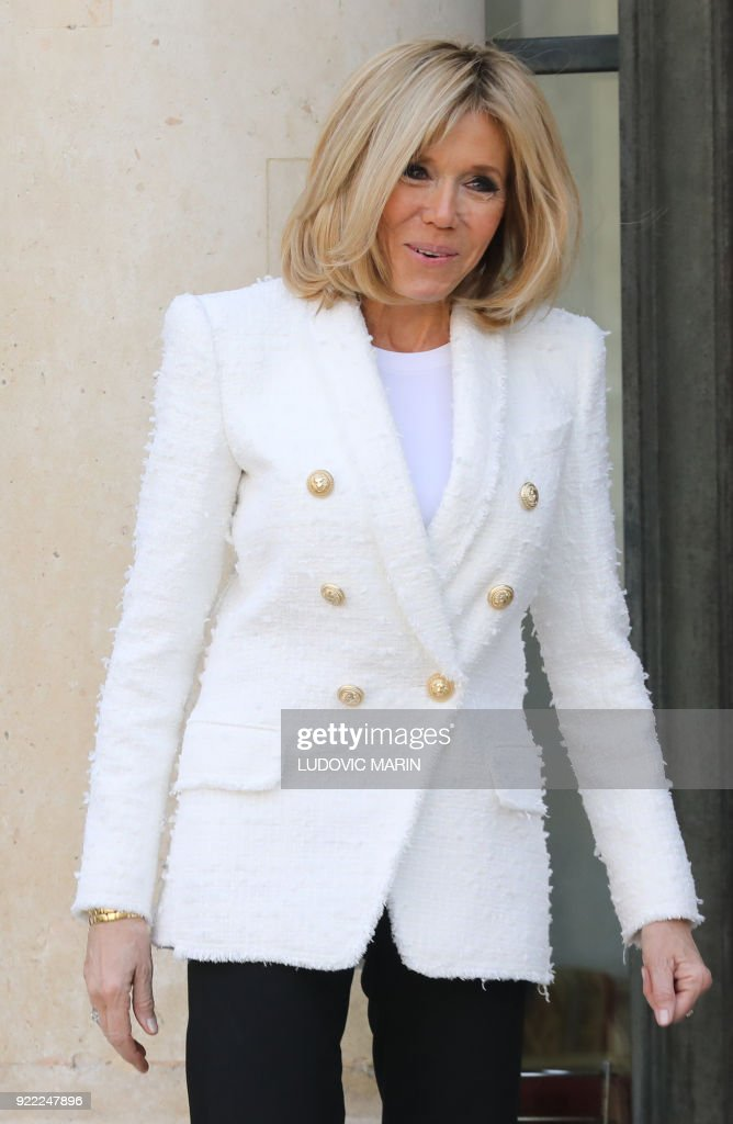 French President's wife Brigitte Macron poses for media representatives as Liberian President's wife Clar Duncan Weah departed from The Elysee Palace in Paris on February 21, 2018, after attending a lunch function. /