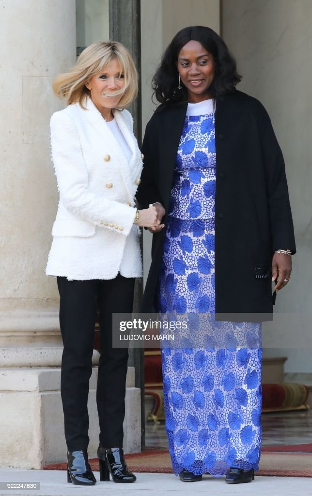 French President's wife Brigitte Macron (L) poses with Liberian President's wife Clar Duncan Weah at The Elysee Palace in Paris on February 21, 2018, after attending a lunch function. /