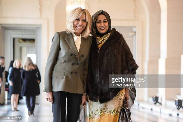 French President's wife Brigitte Macron poses with Tchad's President's wife Hinda Deby Itno as they take part in a spousal event at the Chateau de...