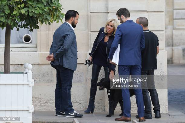 French President's wife Brigitte Macron speaks with colleagues including Elysee senior security officer Alexandre Benalla next to the president's dog...