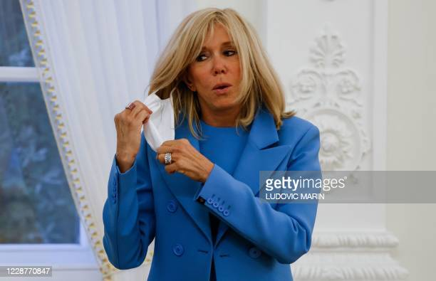 French President S Wife Brigitte Macron Takes Off Her Face Mask After News Photo Getty Images