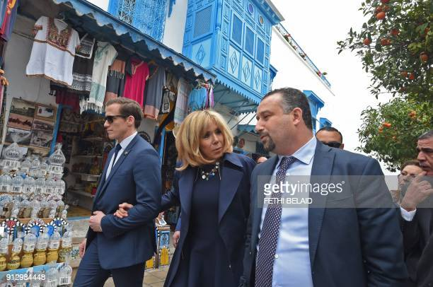 French President's wife Brigitte Macron tours the picturesque village of Sidi Bou Said on the outskirts of the capital Tunis with its's mayor Khalil...