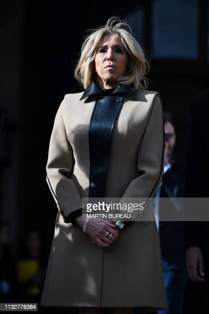 French president's wife Brigitte Macron waits to welcome the Chinese president's wife Peng Liyuan to visit the Palais Garnier opera house in Paris on...