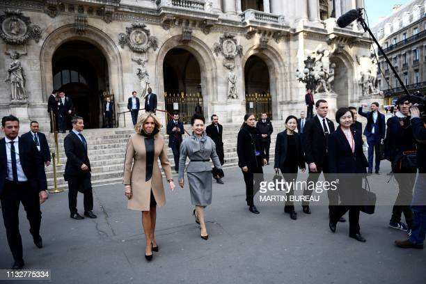 French president's wife Brigitte Macron walks with Chinese president's wife Peng Liyuan during a visit to the Palais Garnier opera house in Paris on...