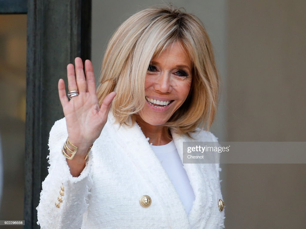 French President's wife Brigitte Macron waves as she accompanies Liberia President's wife Clar Weah after their lunch with French President Emmanuel Macron and Liberian President George Weah at the Elysee Palace on 21 February, 2018 in Paris, France. Weah is a former international soccer player and was elected President of the Republic of Liberia on January 22, 2018, he is currently on an official visit to France.