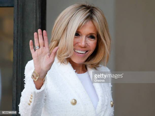 French President's wife Brigitte Macron waves as she accompanies Liberia President's wife Clar Weah after their lunch with French President Emmanuel...