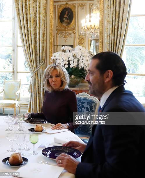 French President's wife Brigitte sits next to Saad Hariri who announced his resignation as Lebanon's Prime Minister while on a visit to Saudi Arabia...