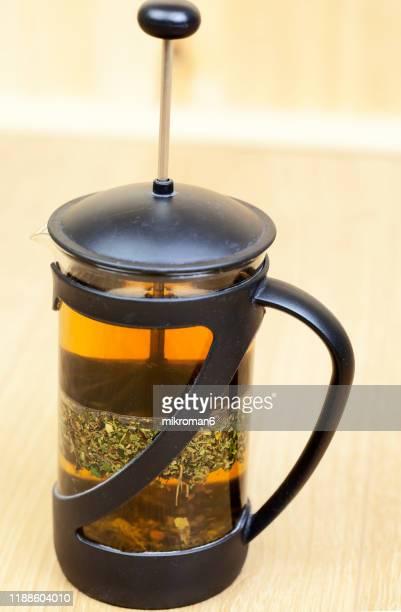 french press with herbal tea - イラクサ ストックフォトと画像