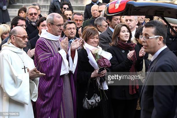 French priest Philippe Desgens applauds next to actress Annie Girardot's daughter Giulia Salvatori and granddaughter Lola Vogel , as Girardot's...