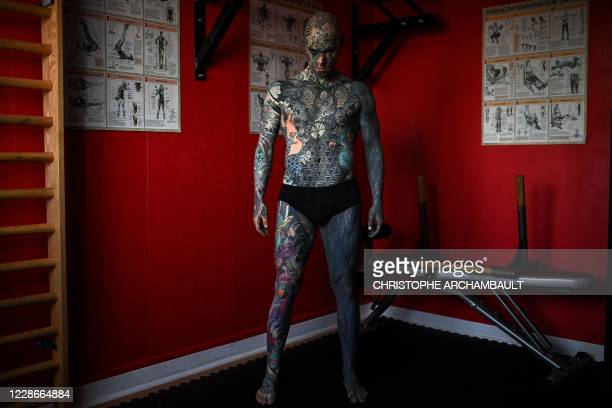 French primary school teacher and tattoo enthusiast Sylvain Helaine, known as Freaky Hoody, poses during a photo session in Palaiseau, a south of...