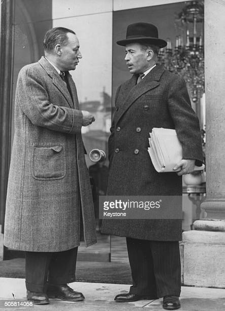 French Prime Minister Antoine Pinay talking to fellow politician after a Cabinet meting outside the Elysee Palace in Paris October 22nd 1952