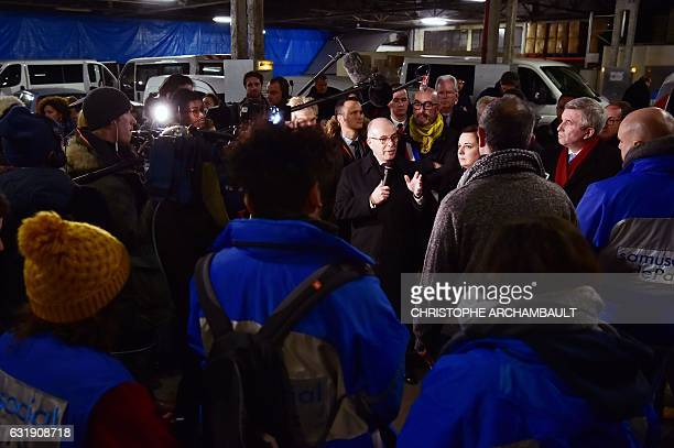 French Prime Minister Bernard Cazeneuve flanked by French Housing Minister Emmanuelle Cosse speaks to SAMU Social workers on January 17 2017 in...