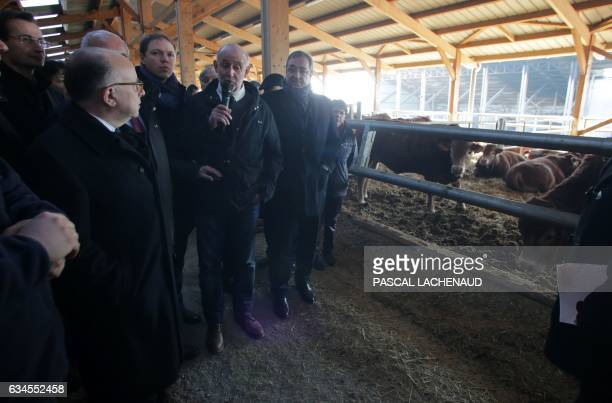 """French Prime Minister Bernard Cazeneuve listens to explanations during a visit at the """"Ferme des 1000 veaux"""" on February 10, 2017 in..."""