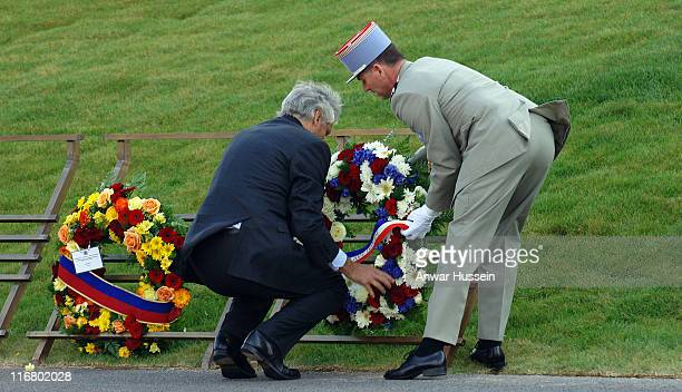 French Prime Minister Dominique de Villepin lays a wreath during a ceremony to mark the 90th anniversary of the Battle of Vimy Ridge in which more...