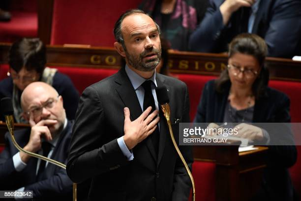 French Prime Minister Edouard Philippe addresses deputies during a session of questions to the government on December 6 2017 at the National Assembly...