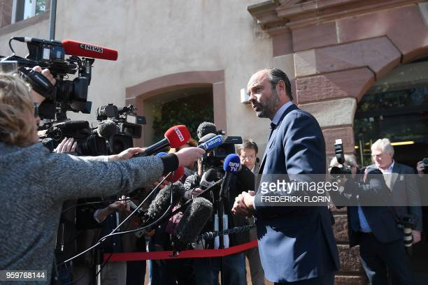 French Prime Minister Edouard Philippe addresses journalists as he arrives for a visit at the Ecole Nationale d'Administration on May 18, 2018 in...