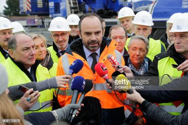 French Prime Minister Edouard Philippe addresses the media as President of the IledeFrance region Valerie Pecresse French Transports Minister...