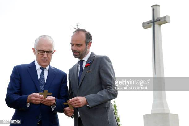 French Prime Minister Edouard Philippe and Australian Prime Minister Malcolm Turnbull speak at the military cemetery in VillersBretonneux on the eve...