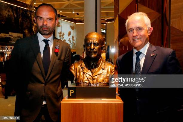 French Prime Minister Edouard Philippe and Australian Prime Minister Malcolm Turnbull pose next to the bust of a soldier during the inauguration...