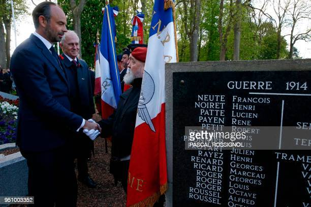 French Prime Minister Edouard Philippe and Australian Prime Minister Malcolm Turnbull shake hands with veterans at the war memorial in...