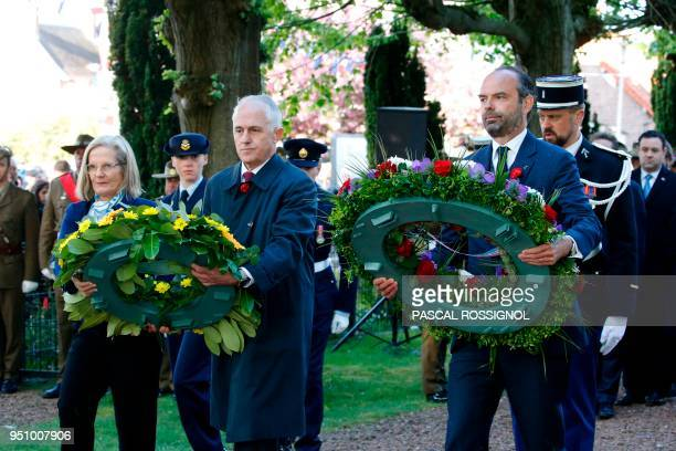 French Prime Minister Edouard Philippe and Australian Prime Minister Malcolm Turnbull lay wreaths at the war memorial in VillersBretonneux northern...