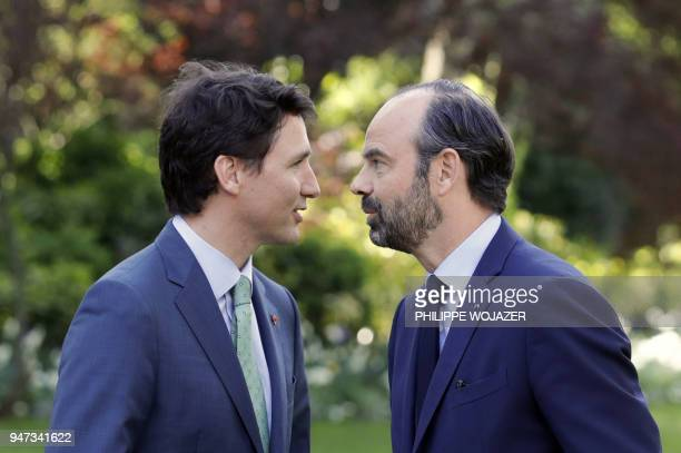 French Prime Minister Edouard Philippe and Canadian Prime Minister Justin Trudeau speak prior to a meeting at the Hotel de Matignon, on April 17,...